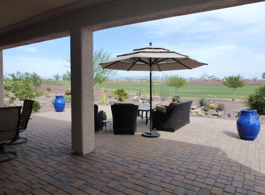 Large brick patio overlooking lawn