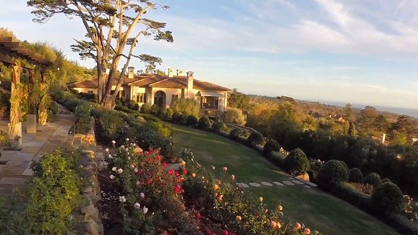 Mediterranean style house with rose garden