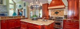 traditional-kitchen-with-custom-range-hood-and-cherry-cabinets