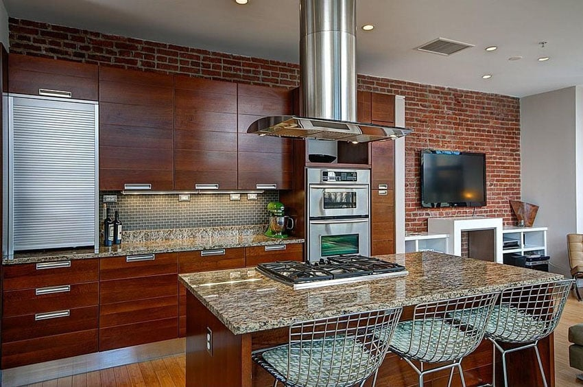 Contemporary kitchen with brick wall granite dining island with built in stove