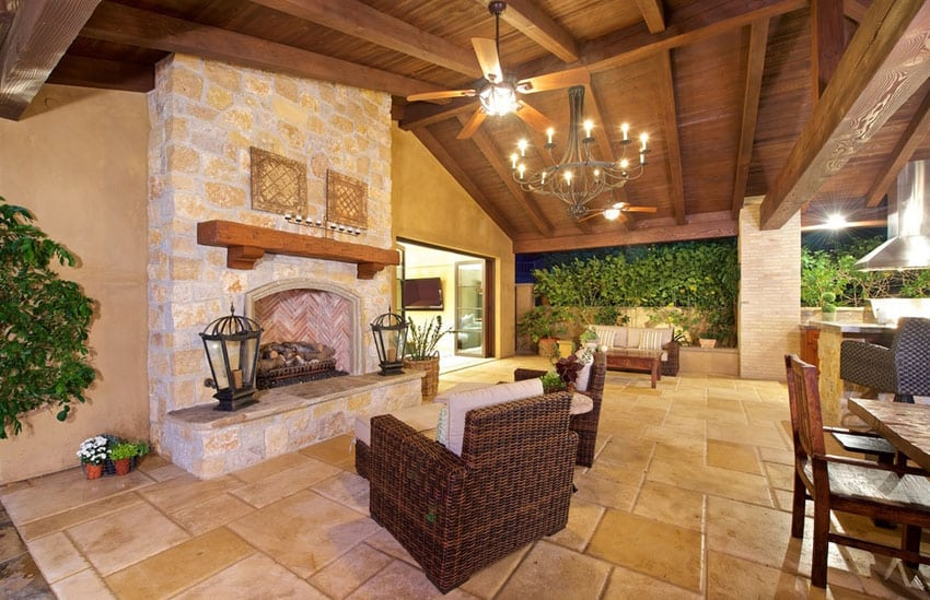 Covered outdoor patio with fireplace and arched wood ceiling