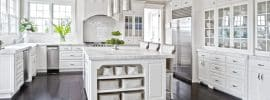 gorgeous-white-cabinet-kitchen-with-marble-counters-and-dark-chocolate-oak-floors