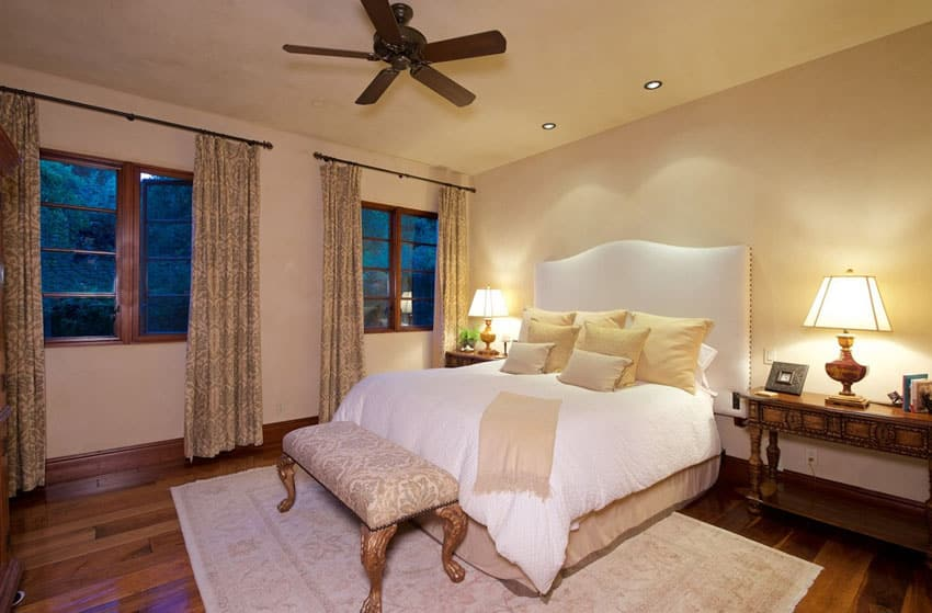 Guest bedroom with wood floors and ceiling fan