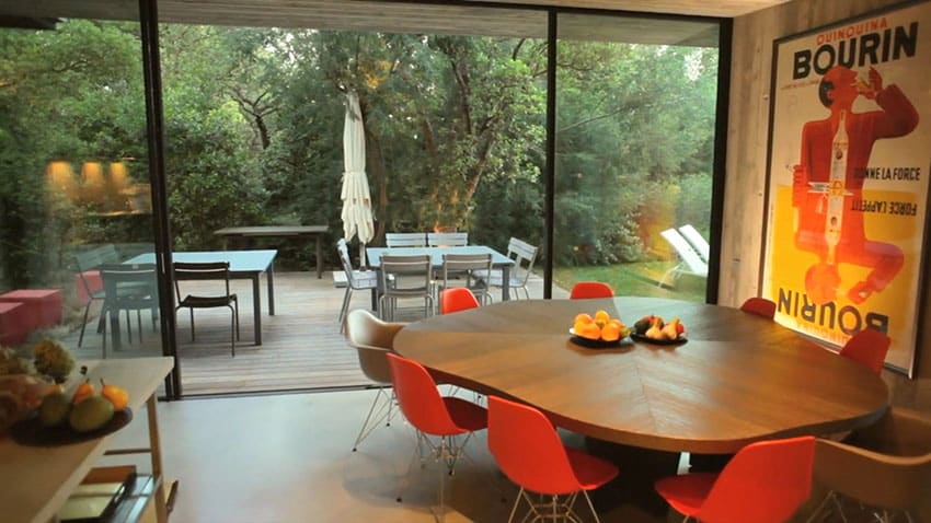 Modern dining room with outdoor views to deck