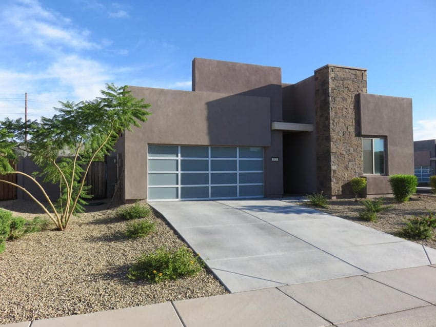 Modern home with concrete driveway