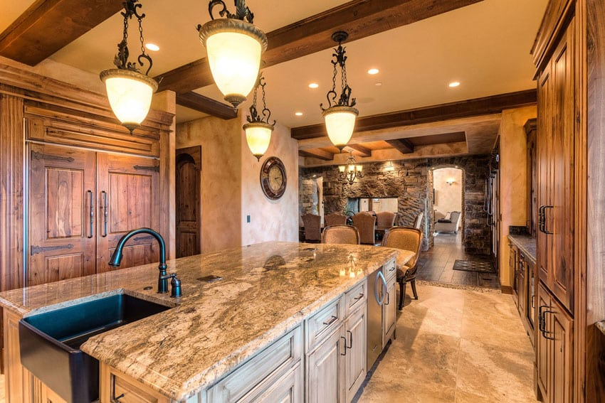 Rustic wood kitchen with wood beams granite island open to dining room