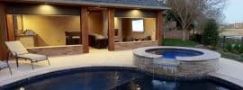 swimming-pool-with-cabana-with-motorized-shades-fireplace