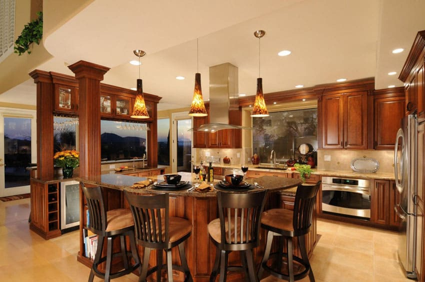 Traditional kitchen with wood cabinets and columns