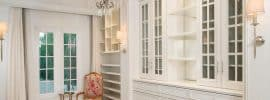 beautiful-white-walk-in-closet-with-chandelier-shoe-rack-and-window