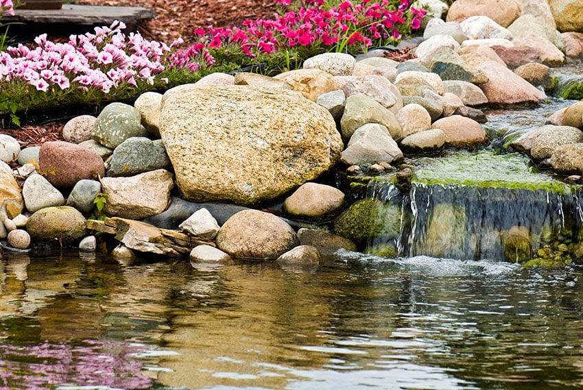 Garden waterfall flowing in to pond