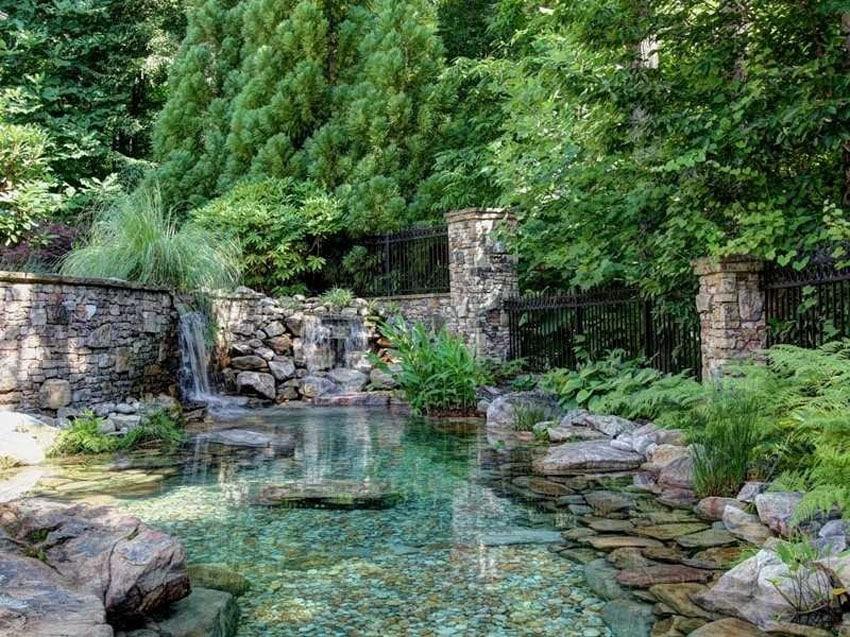 Luxury backyard with aqua pond and waterfall