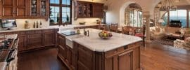 luxury-craftsman-kitchen-with-farmhouse-sink-and-wood-beam-ceiling