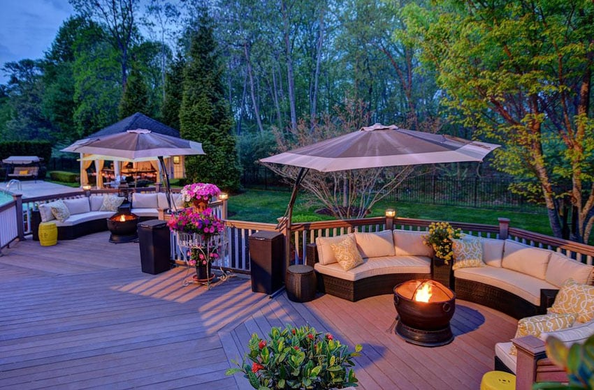 Beautifully decorated composite deck and garden area with canopy