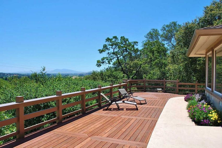 Beautiful wood deck with hillside views next to flower planter
