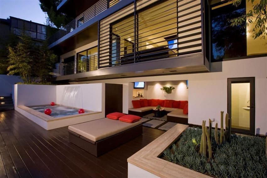 Composite deck behind modern home with water feature