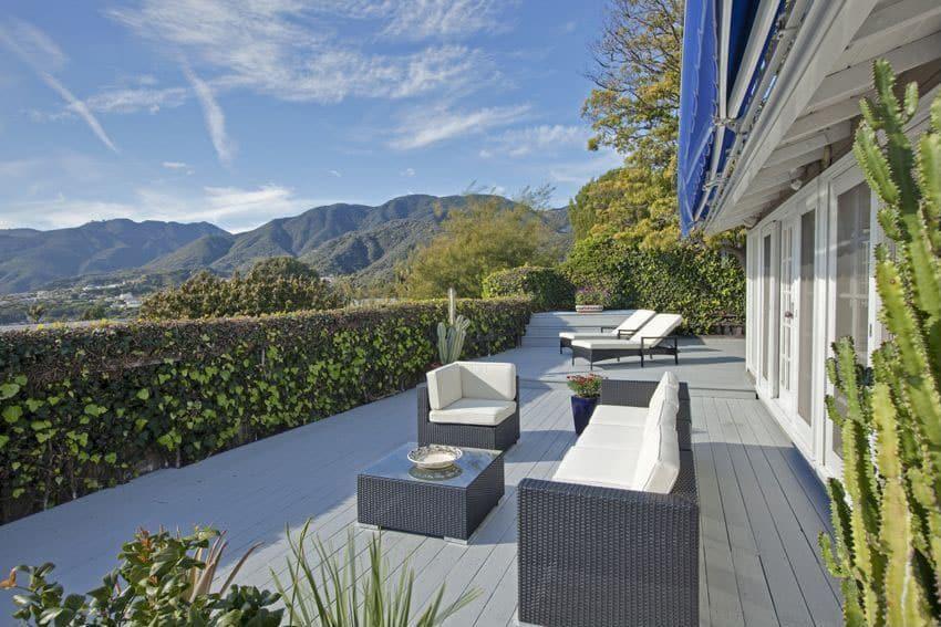 Contemporary composite deck with hillside views