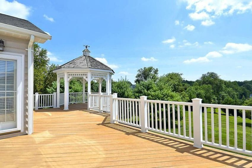 Deck with white painted gazebo and white railings