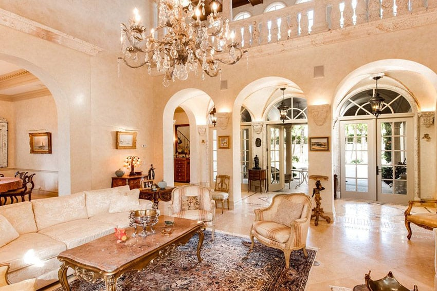 Elegant traditional living room with arched doorways crystal chandelier and high balcony