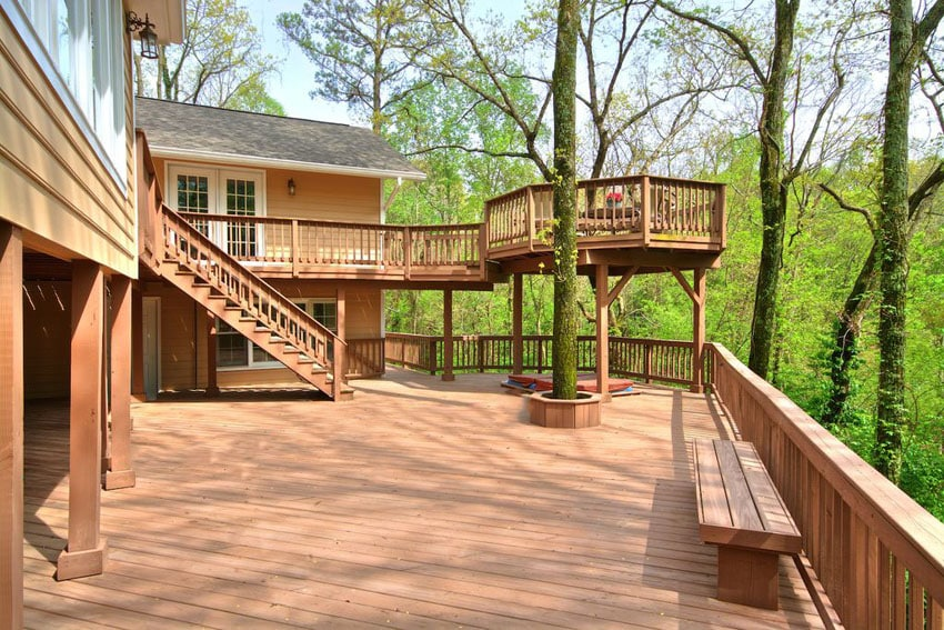 Large two level deck with outlook of surrounding trees