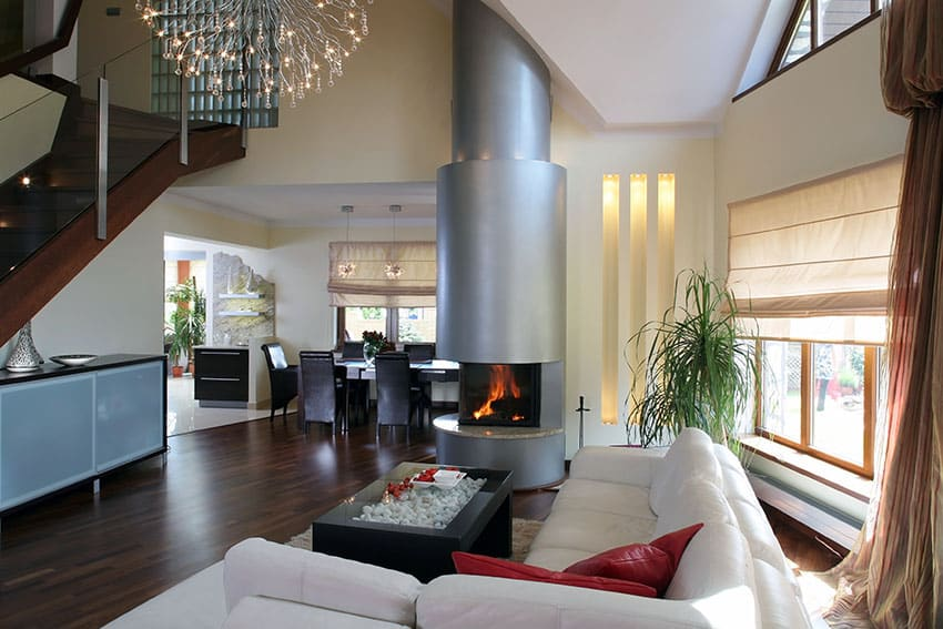 Modern decor living room with wood floors, chandelier and white furniture