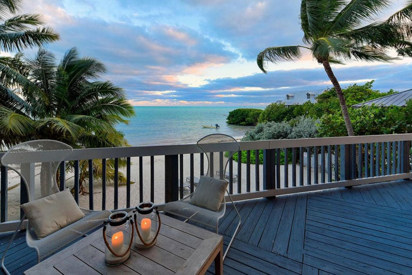 Oceanfront wood deck in florida with tropical palm trees