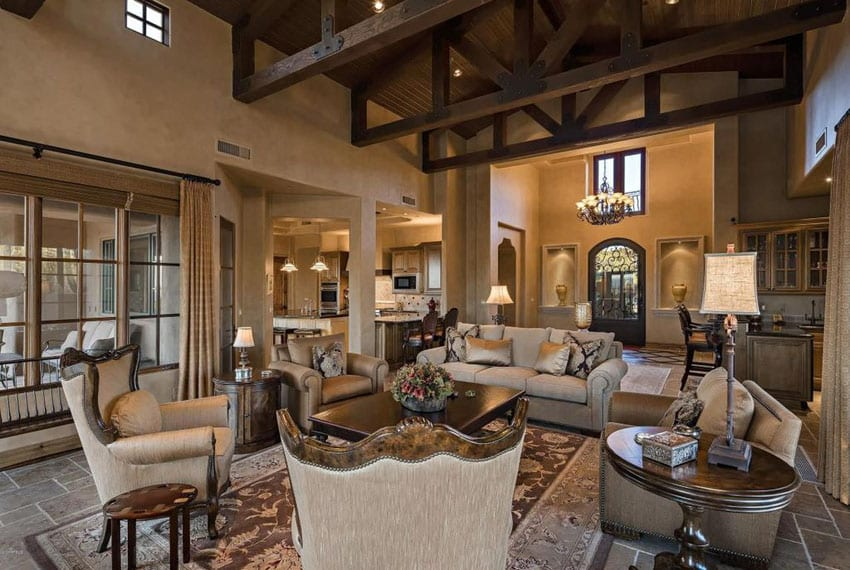 Richly furnished living room with high vaulted ceiling and open beams