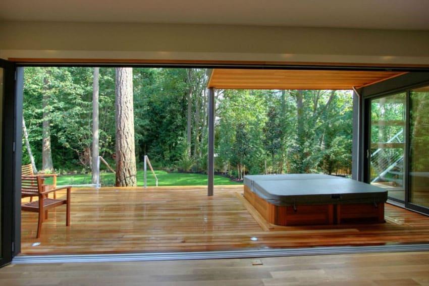 View of wood deck from bedroom through wide doorway