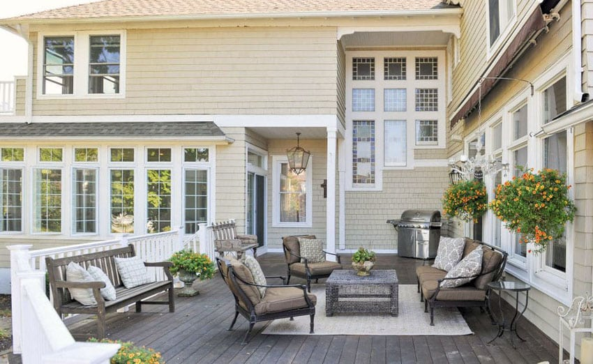 Wood deck at traditional home with white railing and wood benches