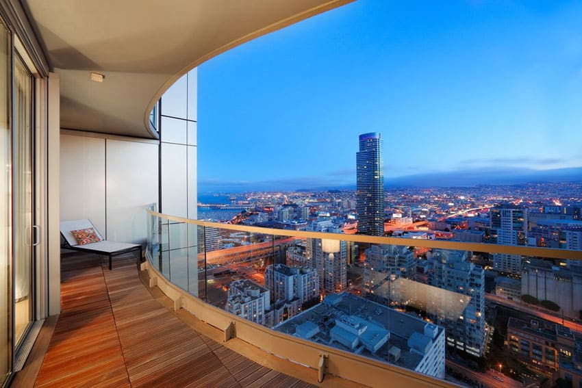 Wood deck in penthouse apartment with city views