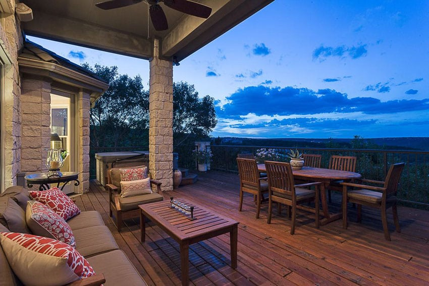 Wood deck with outdoor dining table and hot tub