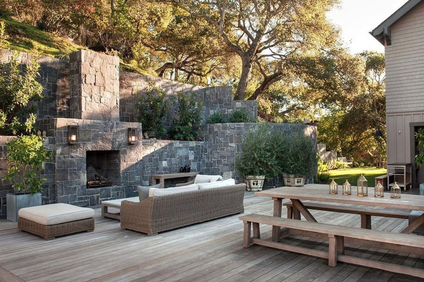 Wood Deck With Stone Fireplace And Picnic Table