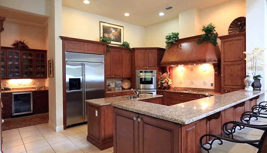 Chefs kitchen with 6 burner gas range and dining peninsula