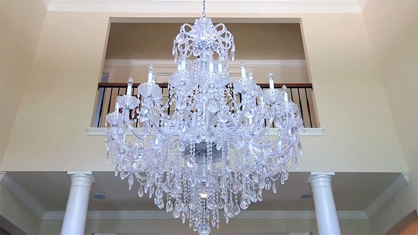 Close up view of beautiful hanging chandelier to upstairs balcony