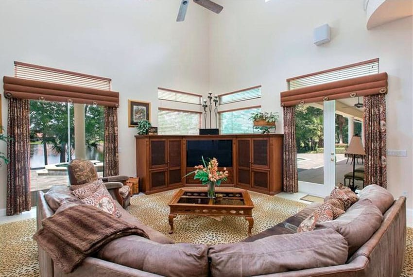 Family room with large couch and views to lake