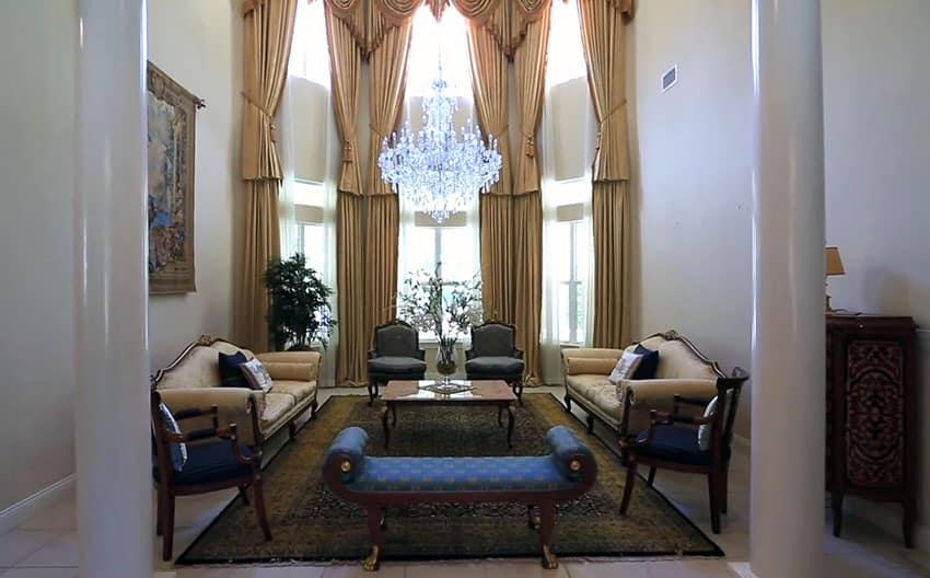 Formal living room with pillars, high ceiling and crystal chandelier