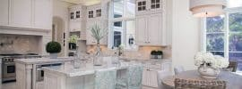 luxury-traditional-kitchen-with-two-islands-damasco-white-marble-counters-and-white-cabinetry-with-glass-doors