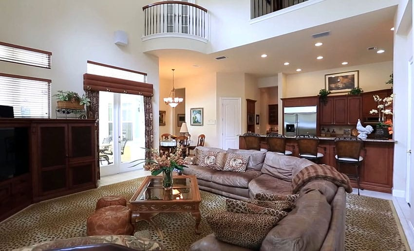 Open living room with high ceiling and upstairs balcony