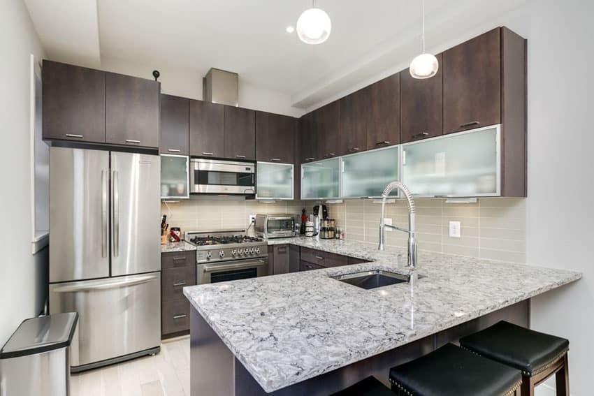 Small dark cabinet contemporary kitchen with peninsula