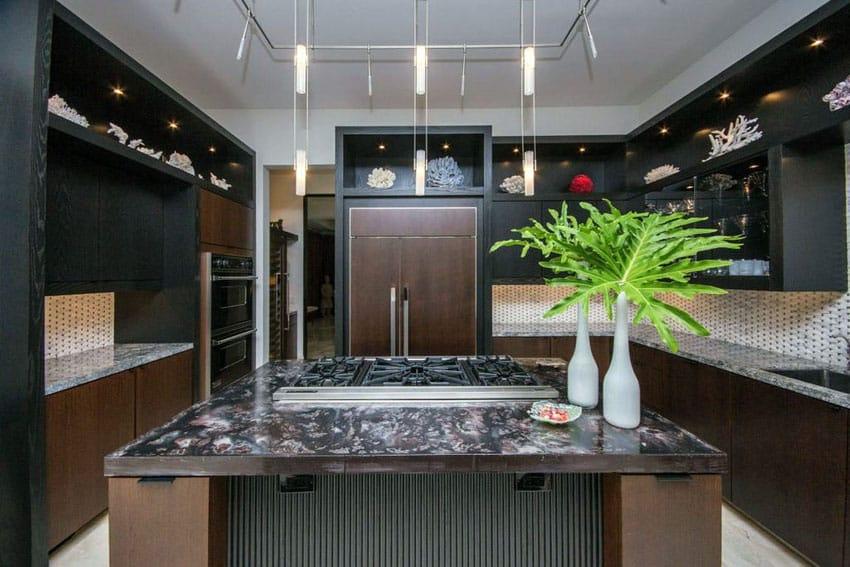 Black cabinet modern kitchen with brown island and light color backsplash