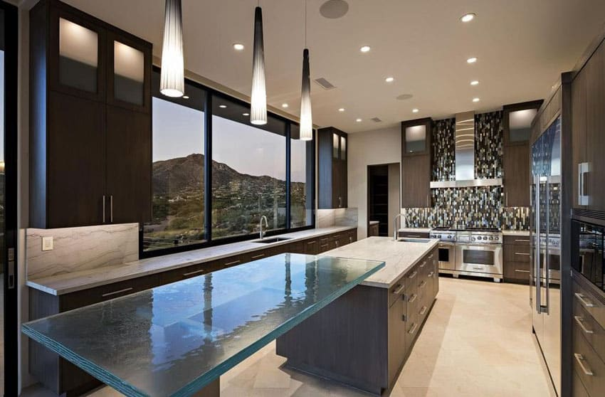 Contemporary kitchen with dark wood cabinets, cone shaped pendant lights and glass breakfast bar island
