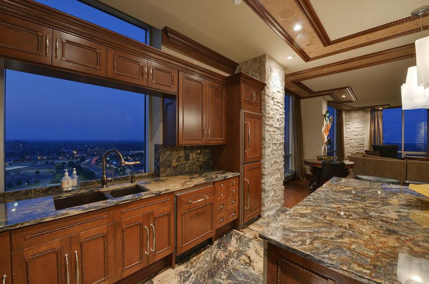 Mediterranean kitchen with one wall design and island with thunder wave granite