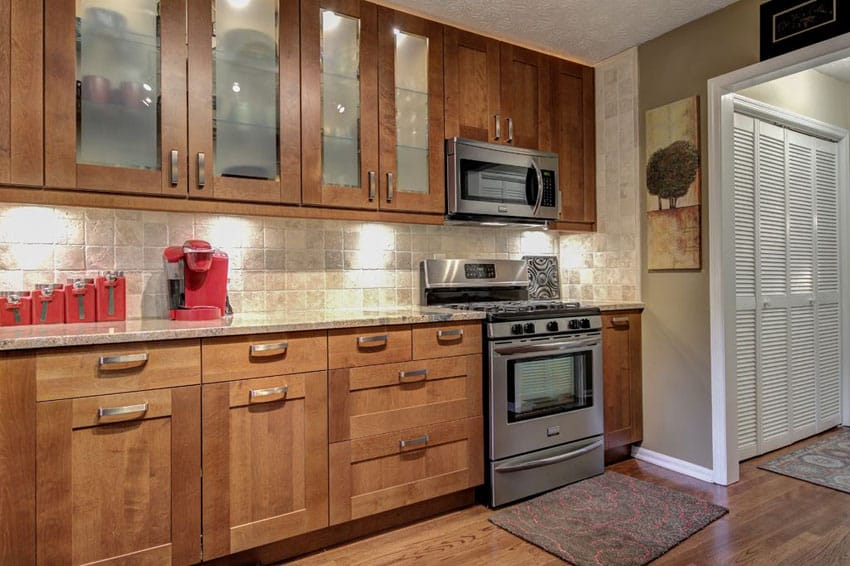 One wall rustic style kitchen with glass door cabinetry