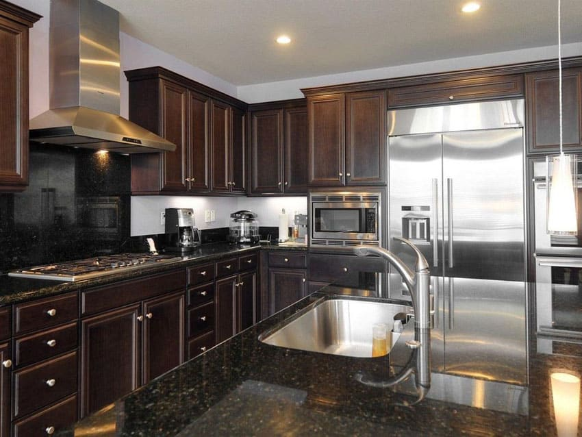 Traditional kitchen with marquis panel cabinets and black granite counter