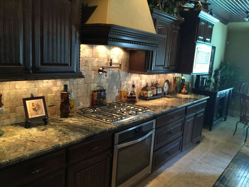 Traditional one wall kitchen with dark wood cabinets and mokoro granite