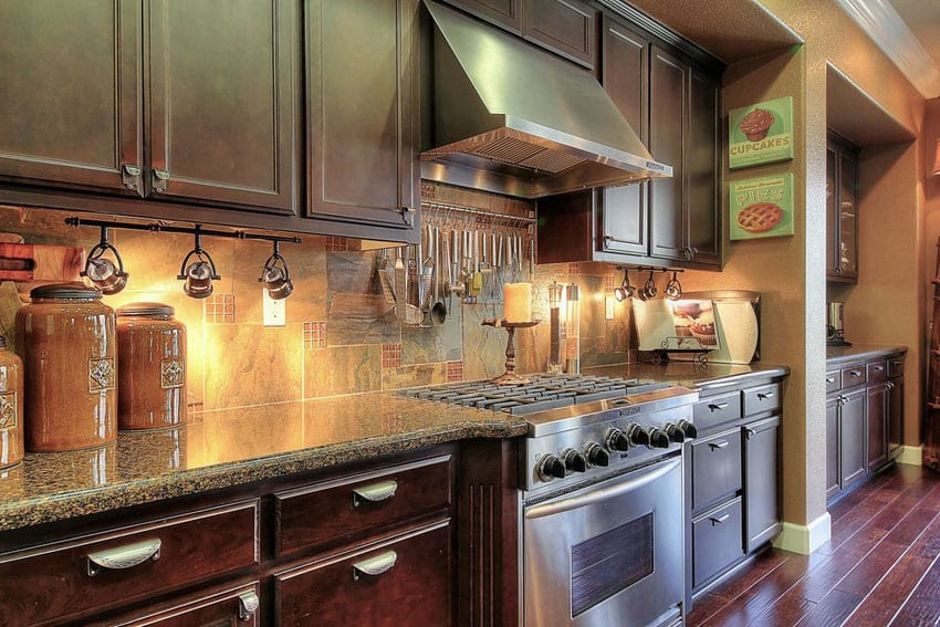 Traditional single line kitchen with dark cabinetry and wood plank floors