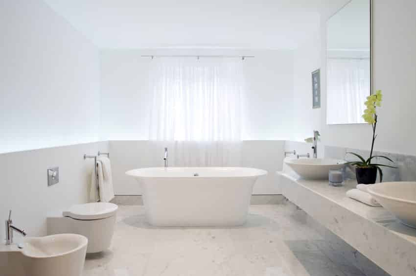 All white modern bathroom with freestanding bathtub