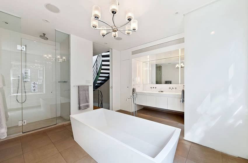 Contemporary master bathroom with silver chandelier and center tub