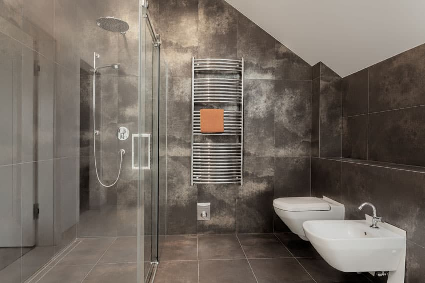 Dark tile bathroom with rainfall shower