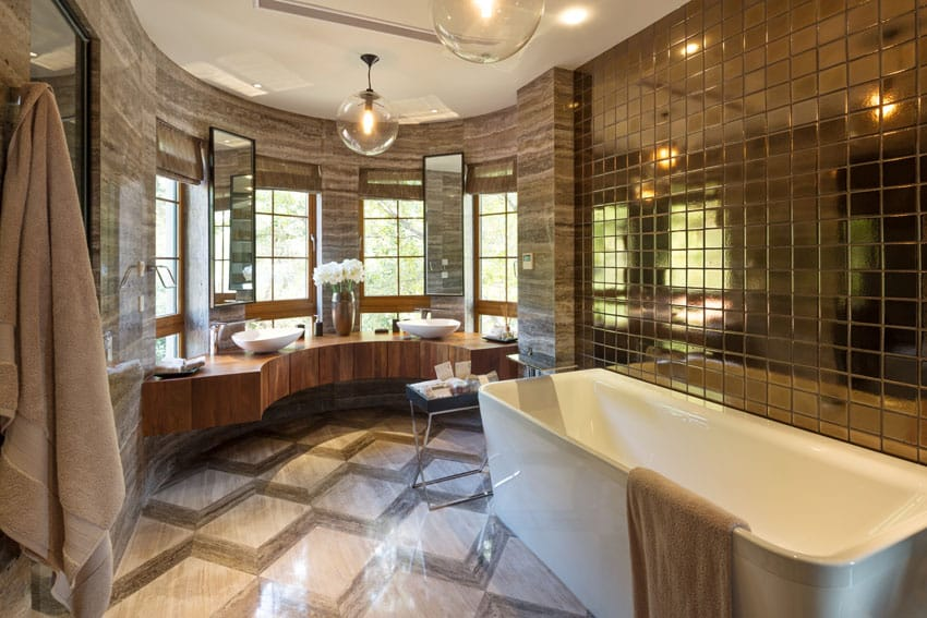 Modern bathroom with gold decor and mirrored metal accent wall