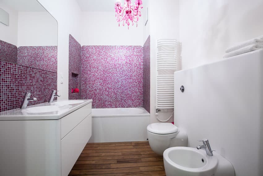 Modern bathroom with pink chandelier and mosaic tile